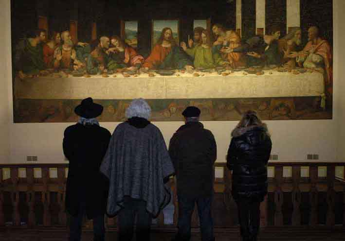 "Storaro, Acosta, Ferretti and Lo Schiavo study a beautiful and faithful replica of <em>The Last Supper</em>; a canvas thought to be executed by Leonardo's studio with the same cartoons used to paint the original and a piece that has been well preserved. Tongerlo Abbey, home to the mural since 1545, is located near Antwerp, in Westerlo Belgium. <span style=""""font-size: 9px;"""">© AFA vzw</span>"