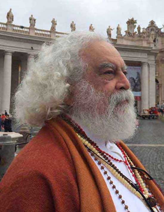 "Armondo Linus Acosta, also known as Siddha Meditation Master Baba Ganapati, in Rome's Vatican Square prior to attending the canonization of Mother Teresa, September 2014. <span style=""""font-size: 9px;"""">© AFA vzw</span>"