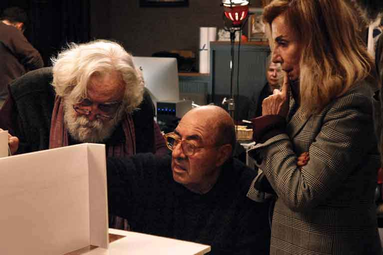 "A scale model of ""The Living Tableau"" set is examined by creator Acosta, legendary production designer Dante Ferretti and his wife and collaborator, storied set designer Francesca Lo Schiavo, both winners of three Academy Awards<sup>®</sup>. <span style=""""font-size: 9px;"""">© AFA vzw</span>"